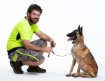 Man with high vis with dog on a leash
